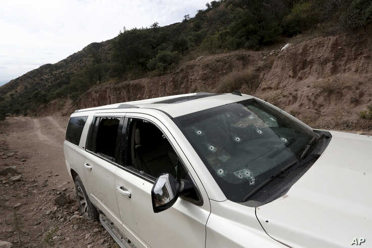 A bullet-riddled vehicle that members of the LeBaron family were traveling in sits parked on a dirt road near Bavispe, Mexico, Nov 6, 2019.