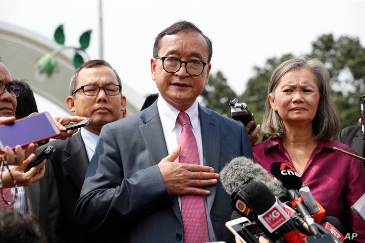 Cambodia's exiled opposition leader Sam Rainsy talks to the media outside Parliament House in Kuala Lumpur, Malaysia, Nov. 12, 2019.
