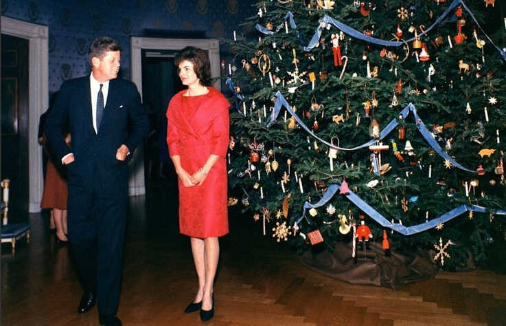 President John F. Kennedy and first lady Jaqueline Kennedy are seen standing next to the White House Christmas tree in a picture taken during the 1961 holiday season. (Source - John F. Kennedy Presidential Library)