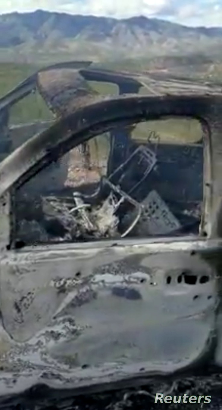 The burnt wreckage of a car that transported a Mormon family is seen in Bavispe, Sonora, Mexico, Nov. 4, 2019, in this picture obtained from social media. (Credit: Kenneth Miller/Lafe Langford Jr.)