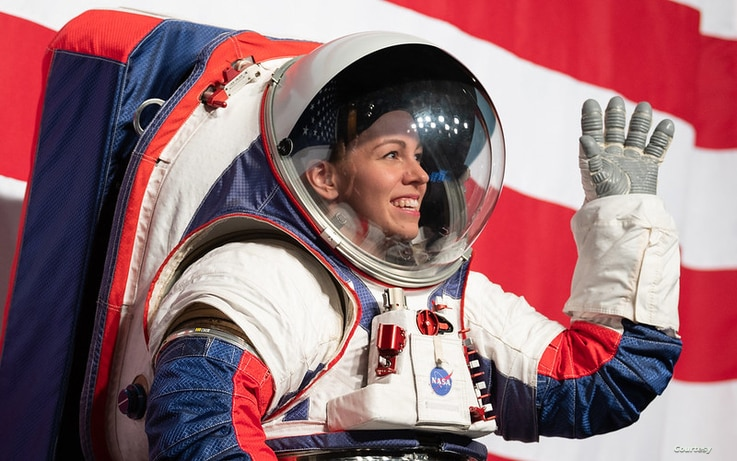 Kristine Davis, a spacesuit engineer at NASA's Johnson Space Center, wearing a ground prototype of NASA's new Exploration Extravehicular Mobility Unit (xEMU), is seen during a demonstration of the suit, Oct. 15, 2019 at NASA Headquarters in Washington. (NASA/Joel Kowsky)