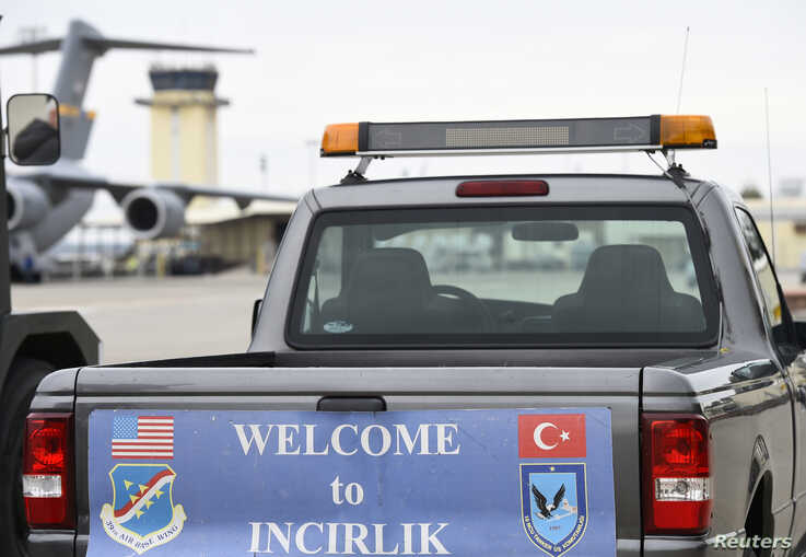 FILE - A service vehicle with a sign reading 'Welcome to Incirlik' is pictured at Incirlik Air Base, near Adana, Turkey, Jan. 21, 2016.