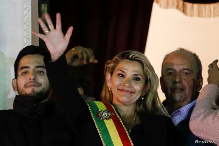 Bolivian Senator Jeanine Anez gestures after she declared herself as interim President of Bolivia, at the balcony of the Presidential Palace, in La Paz, Bolivia, Nov. 12, 2019.