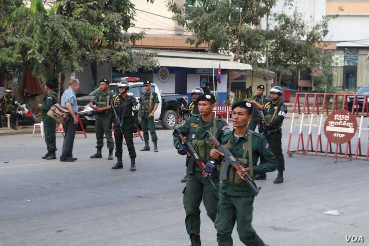 Armed police block all roads leading to Poipet border checkpoint in Cambodia, as leaders and activists of Cambodia National Resc