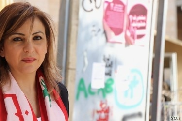 Nadira Fawas, the president of the Lebanese Gymnastics Federation joins the demonstrations daily, saying she wants a country in which her children can afford to stay home, pictured in Beirut on Nov. 14, 2019. (Heather Murdock/VOA)