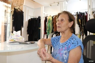 Mouneera Saad's dress shop has nearly been run out of business by the nearby demonstrations, but she says she understands the anger. Pictured in Beirut on Nov. 14, 2019. (Heather Murdock/VOA)