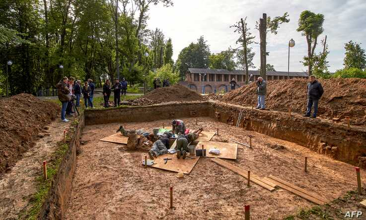 Archaeologists work on July 7, 2019 at a site of the supposed burial place of French General Charles Etienne Gudin de la…