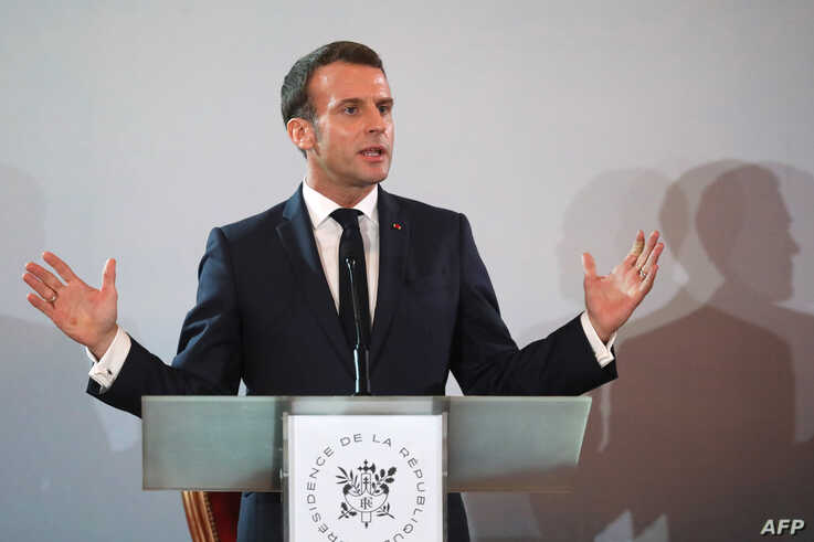 French President Emmanuel Macron speaks during a press conference at the Presidential Palace in Abidjan on December 21, 2019, during a three day visit to West Africa.