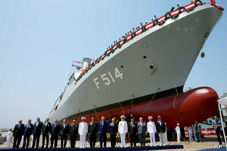 Turkey's President Recep Tayyip Erdogan, bottom center, accompanied by officials pose for photographs during the launch of a new Turkish Navy ship, in Tuzla, outside Istanbul, July 3, 2017.