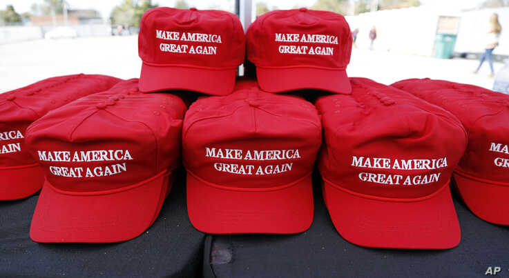 """Make America Great Again"" hats available for purchase outside an arena in Tupelo, Miss., Nov. 1, 2019, ahead of a Keep America Great rally."