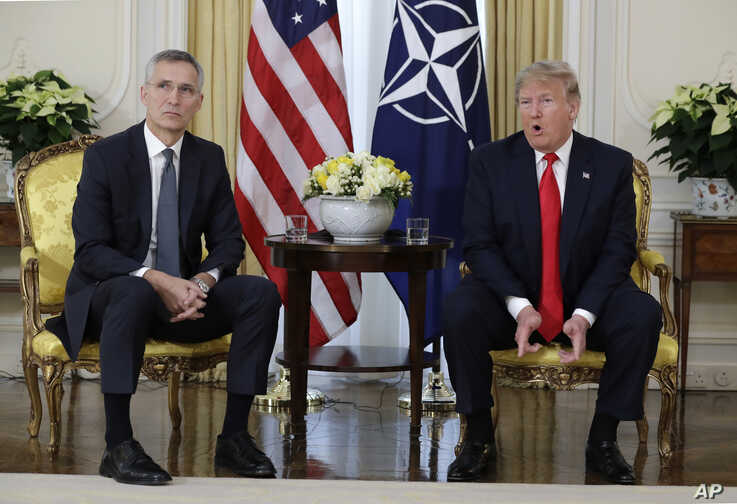 U.S. President Donald Trump speaks during a meeting with NATO Secretary General, Jens Stoltenberg at Winfield House in London.