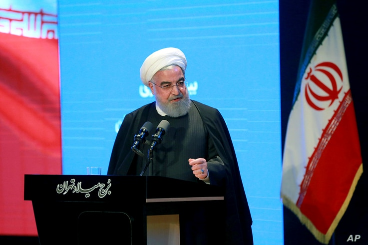 In this photo released by the official website of the Office of the Iranian Presidency, President Hassan Rouhani speaks in a…