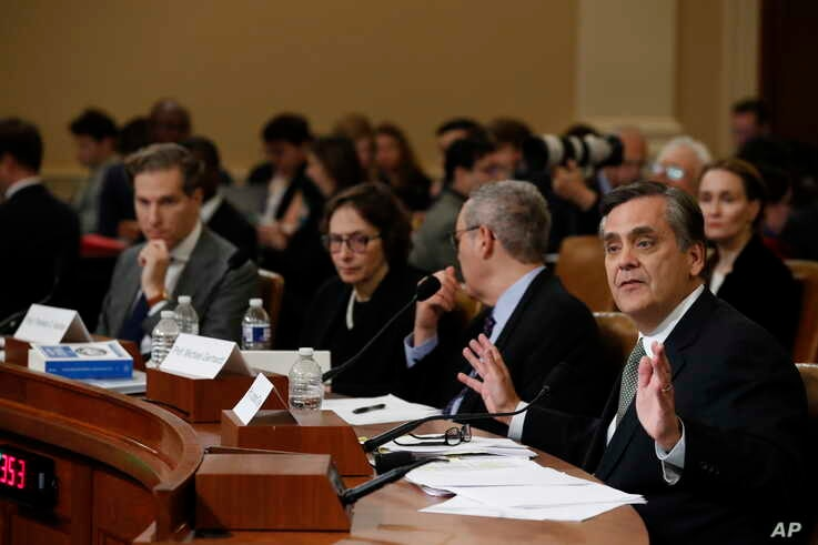 George Washington University Law School professor Jonathan Turley testifies during a hearing before the House Judiciary Committee on the constitutional grounds for the impeachment of President Donald Trump, on Capitol Hill in Washington, Wednesday, Dec. 4, 2019. From left,Harvard Law School professor Noah Feldman, Stanford Law School professor Pamela Karlan and University of North Carolina Law School professor Michael Gerhardt.