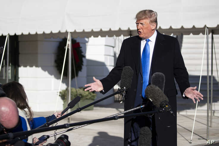 President Donald Trump speaks with reporters before boarding Marine One on the South Lawn of the White House, Dec. 7, 2019.