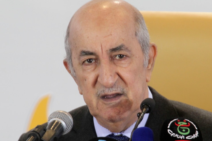 FILE - Newly elected Algerian President Abdelmadjid Tebboune speaks during a press conference Friday, Dec.13, 2019 in Algiers…