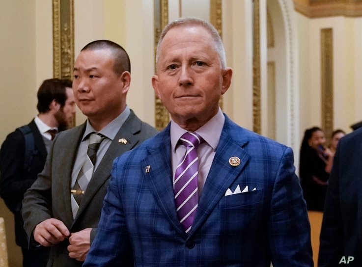 Rep. Jeff Van Drew of New Jersey departs after the House of Representatives voted to impeach President Donald Trump on two…