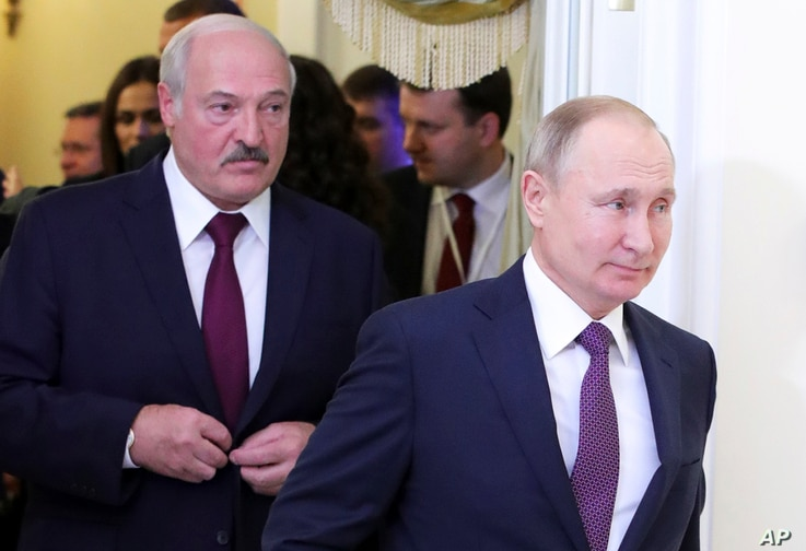Russian President Vladimir Putin, right, and Belarusian President Alexander Lukashenko walk before a meeting of the Supreme…