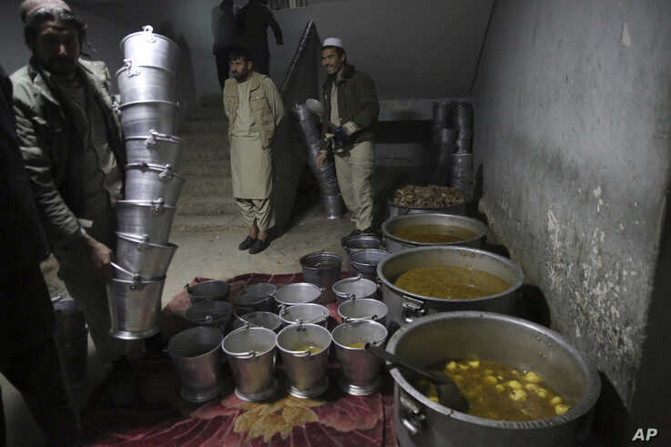 In this Saturday, Dec. 14, 2019, photo, cooks prepare dinner food for Jailed Taliban inside the Pul-e-Charkhi jail in Kabul,…