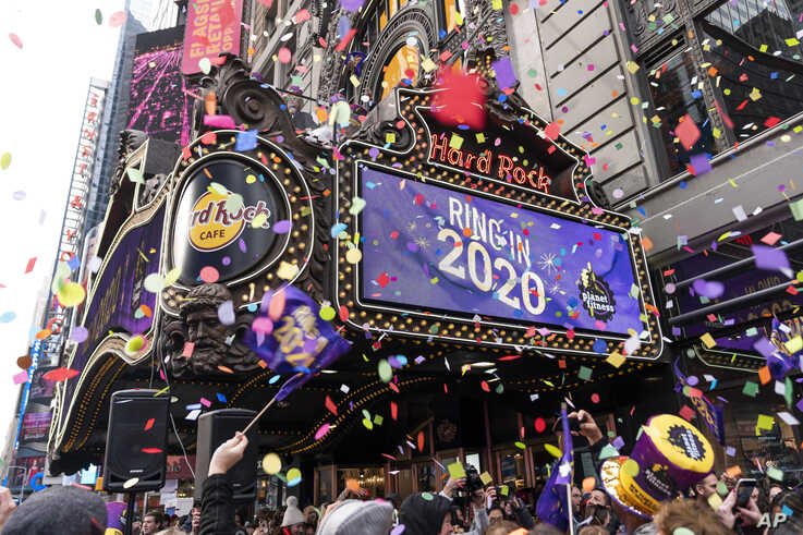 """FILE - The """"air worthiness"""" of confetti is tested by Planet Fitness, in partnership with Times Square Alliance, prior to Times Square's New Year's Eve 2020 celebration in New York City, Dec. 29, 2019."""