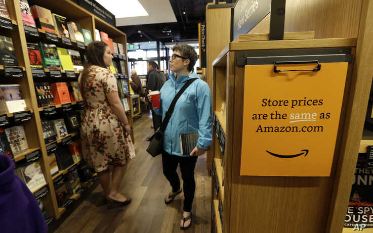 Customers browse the aisles at the Amazon Books store in Seattle, Nov. 3, 2015.