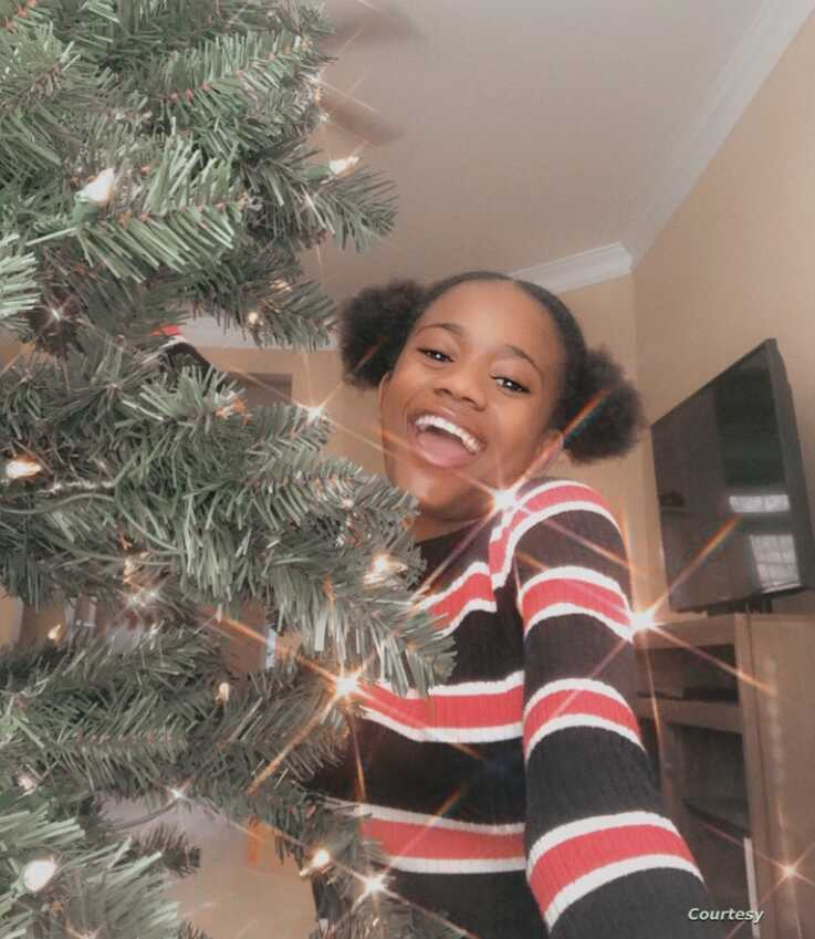 Calvina Hoff poses with the Christmas tree at her aunt's house in Georgia. (Courtesy photo Calvina Hoff)