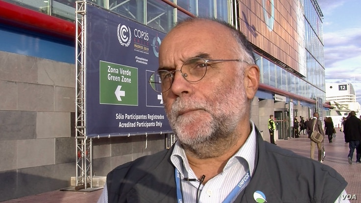 Environmentalists attending the Madrid climate talks, like Ramon Marti, support wind energy but worry badly sited farms could harm birds and bats. (Lisa Bryant/VOA)