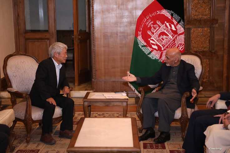 A file photo of slain Japanese doctor, Tetus Nakamura, from a recent meeting with Afghan President Ashraf Ghani.