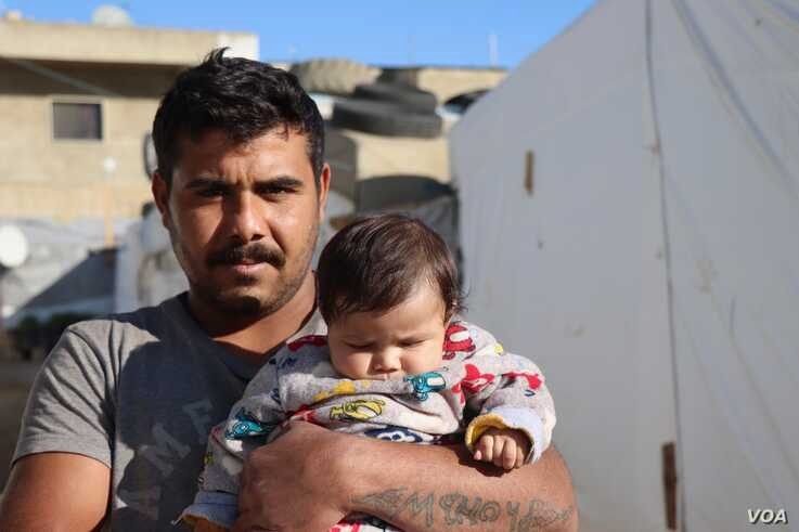 Mahmoud and his neighbors say their houses have been destroyed, and even if they felt it was safe to return to Syria, they have no money to re-settle on Dec. 3, 2019 in the Bekkaa Valley in Lebanon. (Heather Murdock/VOA)