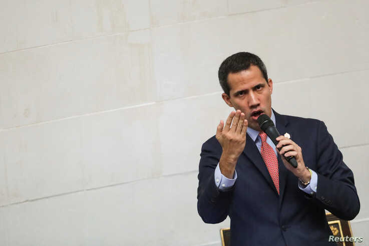 Venezuelan opposition leader Juan Guaido, who many nations have recognised as the country's rightful interim ruler gestures as…