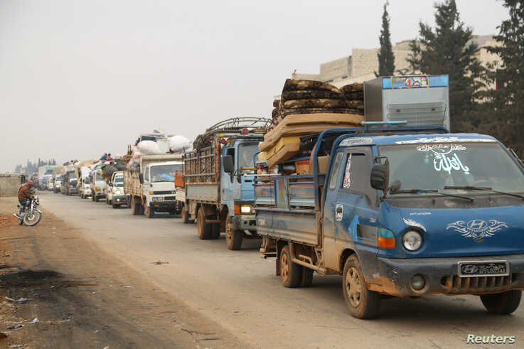 Trucks carry belongings of people fleeing from Maaret al-Numan, in northern Idlib, Syria December 24, 2019. REUTERS/Mahmoud…