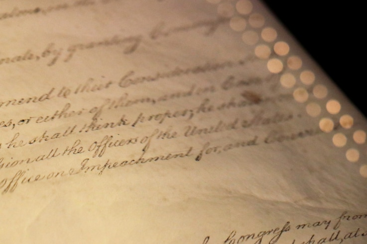 The word 'Impeachment' as it is written in Article II of the U.S. Constitution, is seen on display in the Rotunda for the Charters of Freedom at the National Archives Museum in Washington.