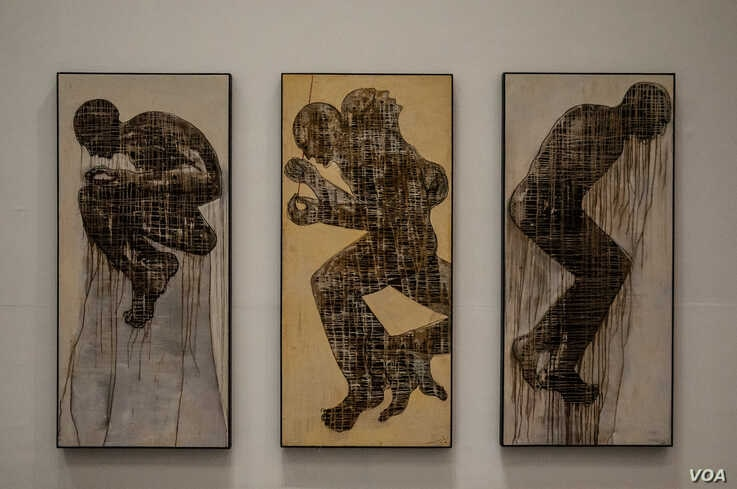 An untitled wax and pigment on wood by Moroccan artist Mahi Binebine is displayed at Dakar's Museum of Black Civilizations.  (Photo: A. Hammerschlag/VOA)