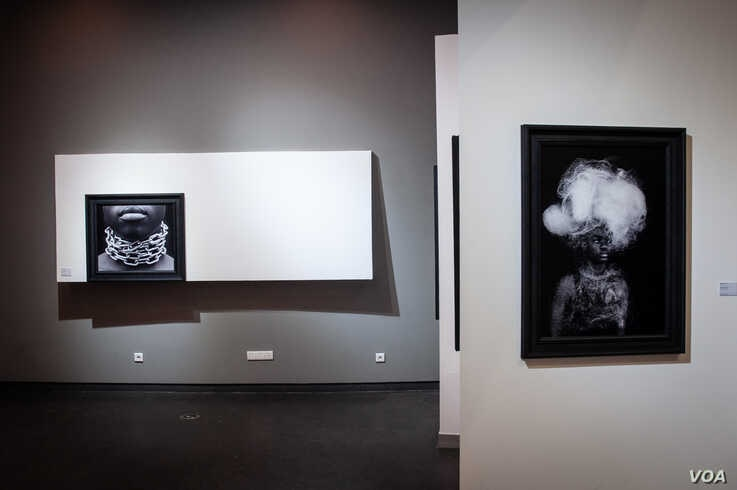 """Photographs by Cameroonian artist Angèle Etoundi Essamba titled """"Rêve brisé"""" are displayed at Dakar's Museum of Black Civilizations. (Photo: A. Hammerschlag/VOA)"""