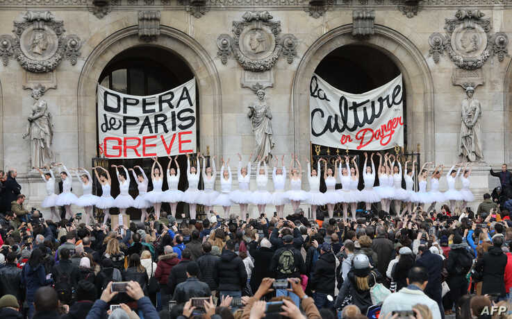 Paris Opera dancers perform in front of the Palais Garnier against the French government's plan to overhaul the country's retirement system, in Paris, France.