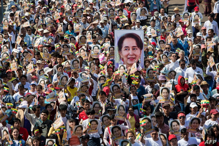 People participate in a rally in Yangon, in support of Myanmar's State Counsellor Aung San Suu Kyi, as she prepares to defend Myanmar at the International Court of Justice in The Hague against accusations of genocide against Rohingya Muslims.