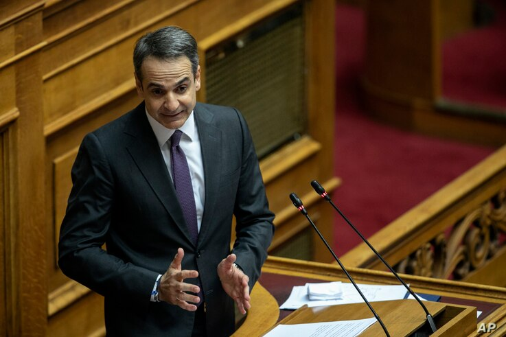 Greece's Prime Minister Kyriakos Mitsotakis, delivers a speech during a parliament session in Athens, Dec. 18, 2019.