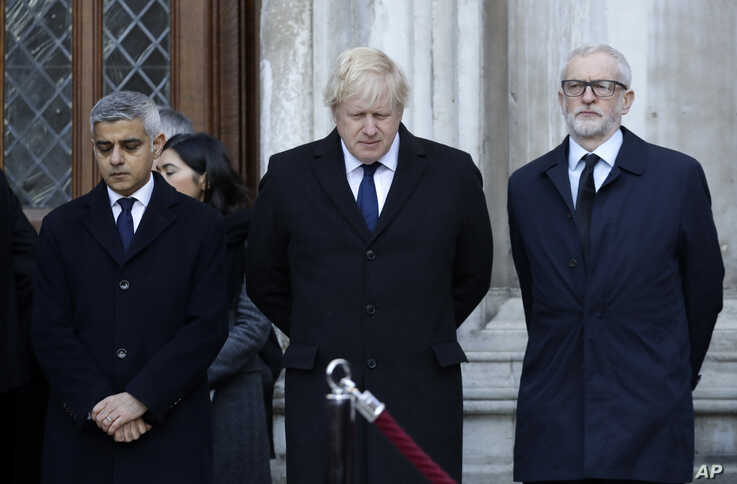 Britain's Prime Minister Boris Johnson, center, Labour Party leader Jeremy Corbyn, right, and Mayor of London Sadiq Khan take part in a vigil in memory of the attack victims, at Guildhall Yard in London, Dec. 2, 2019.