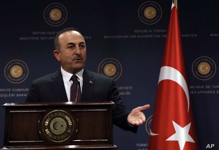 FILE - Turkey's Foreign Minister Mevlut Cavusoglu speaks during a news conference in Ankara, Turkey, Oct. 25, 2019.
