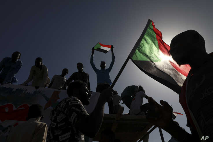 People gather as they celebrate the first anniversary of mass protests that led to the ouster of former president and longtime autocrat Omar al-Bashir, in Khartoum, Sudan, Dec. 19, 2019.