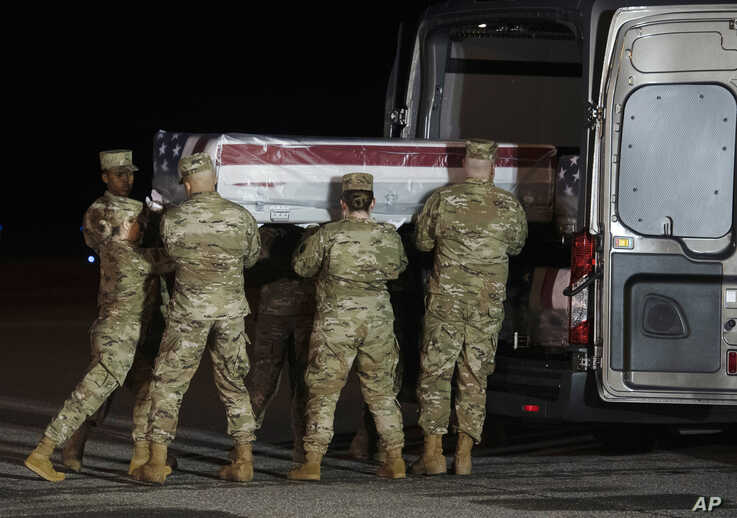 An Air Force carry team loads the remains of Airman Apprentice Cameron Scott Walters into a vehicle at Dover Air Force Base, Delaware, Dec. 8, 2019. Walters was among those killed in the shooting at Naval Air Station Pensacola in Florida.