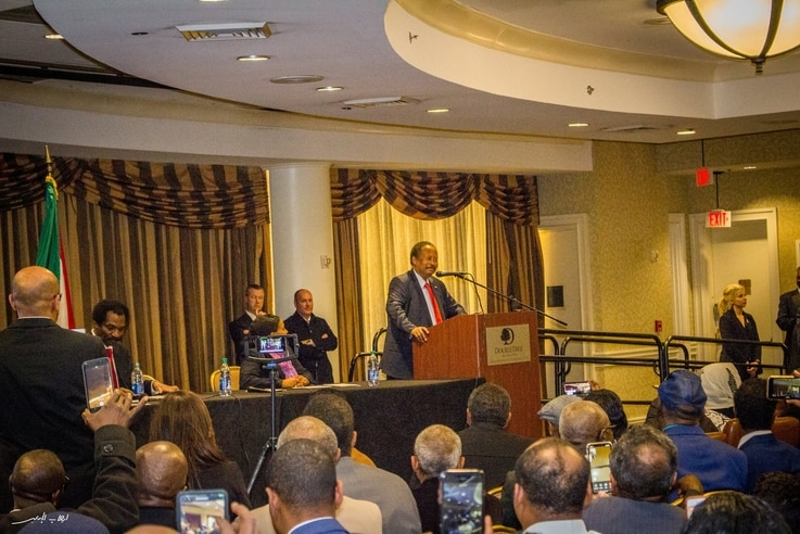 Sudan's Prime Minister Abdalla Hamdok addresses members of the Sudanese diaspora in a Washington hotel during his recent visit to the U.S. capital. (Twitter - @SudanPMHamdok)