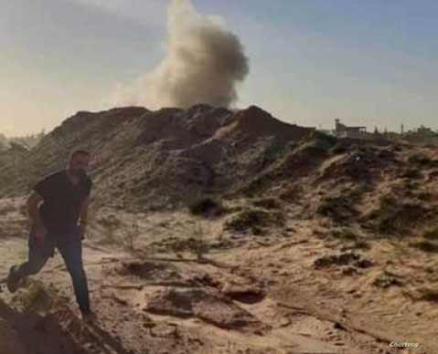 A soldier near Tripoli, Libya, runs as a mortar hits a nearby berm, Dec. 2019 (Courtesy - GNA soldiers)