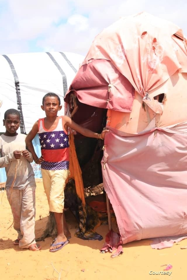 Two Yemeni boys posing next to their tent in the Yemeni Refugees Camp located in the outskirts of Somali capital Mogadishu. ( Courtesy of Muslim Aid)