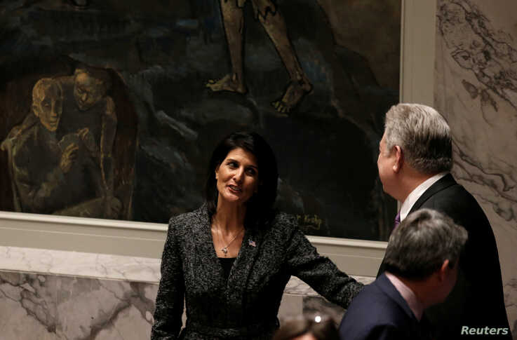 FILE - Then-U.S. Ambassador to the United Nations Nikki Haley speaks with Ukraine's envoy to the U.N. Volodymyr Yelchenko before a Security Council meeting at U.N. headquarters, in New York, Feb. 28, 2017.