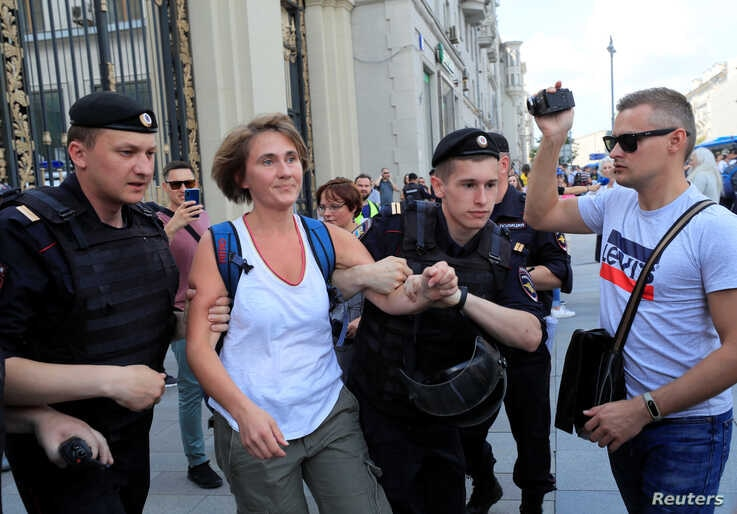 FILE - Law enforcement officers detain a local Reuters journalist during an opposition rally, in Moscow, Russia, July 27, 2019.