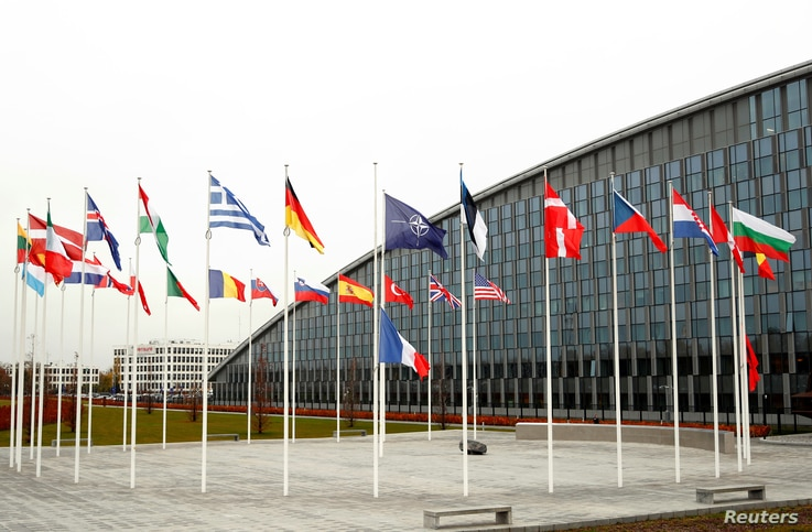 Flags of NATO member countries are seen at the Alliance headquarters in Brussels, Belgium, Nov. 26, 2019.
