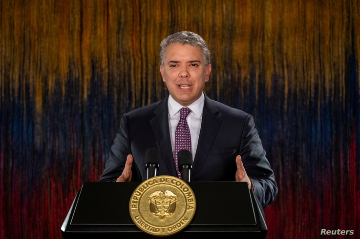 FILE - Colombia's President Ivan Duque addresses the nation in a televised speech, in Bogota, Colombia, Nov. 22, 2019.