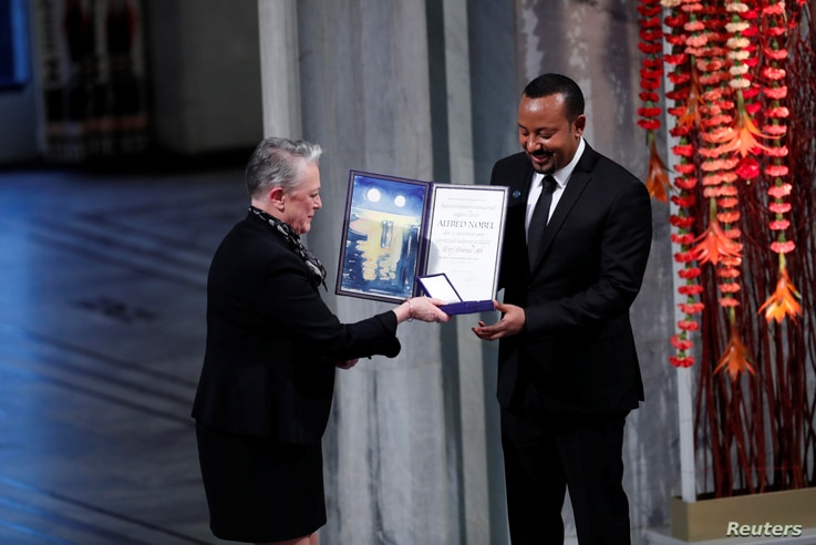 Ethiopian Prime Minister Abiy Ahmed Ali receives medal and diploma from Chair of the Nobel Comitteee Berit Reiss-Andersen during Nobel Peace Prize awarding ceremony in Oslo City Hall, Norway.