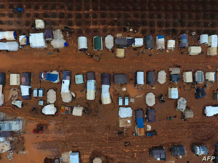 An aerial photograph shows tents sheltering Syrians who fled ongoing battles in the southern and eastern coutryside of the…