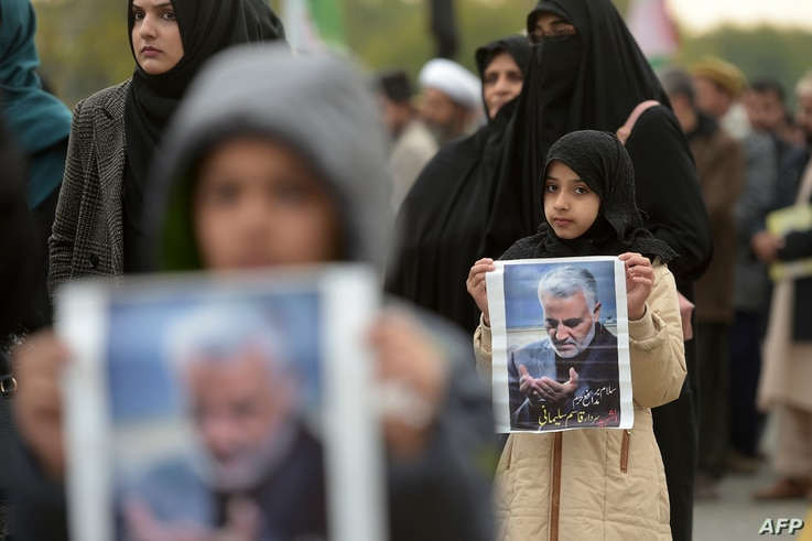 Protesters carry posters with the image of top Iranian commander Qassem Soleimani, who was killed in a U.S. airstrike in Iraq, during a demonstration in Islamabad, Jan. 3, 2020.